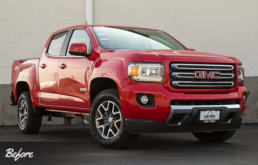 2016 red GMC Canyon before all-terrain accessories