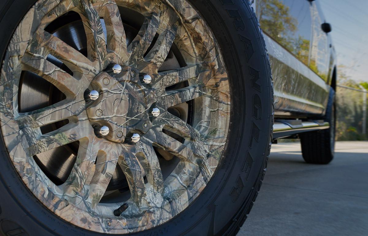 RealTree Camo Vinyl Wrap package on a 2016 Ford F150 with camo wrapped wheels